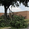 Staff photo by Cathy Spaulding<br /> Torn branches hang from a tree on the Fort Gibson Schools campus Friday. Storms split trees and blew air conditioning units off school roofs on Thursday.