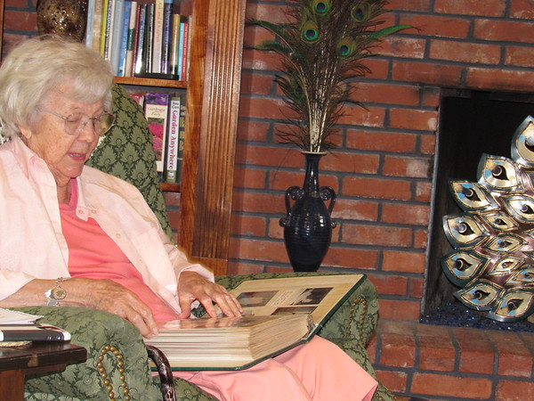Staff photo by Cathy Spaulding<br /> Dorothy Garrison looks through one of her many photo albums. The albums document her 98 years of living in Muskogee.