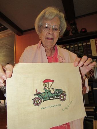 Staff photo by Cathy Spaulding<br /> Dorothy Garrison shows embroidery she did on an old sewing machine. She used to teach sewing and sell machines in downtown Muskogee.