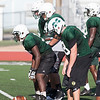 Phoenix special photo by Von Castor<br /> Muskogee linemen Reece Blasingame, Trent Pouncil, Wendel Johnson, Parker Hall and Devonn Harris line up during a play in the Roughers' team camp last week.