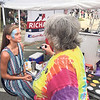 Special photo by Travis Sloat<br /> Hannah McDoulett, 12, from Adair, has her face painted by Mary Hopkins from Magic Mirror Face and Body Art of Guthrie.