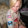 Staff photo by Cathy Spaulding<br /> Susana Jackman shows some of the patches she wears as district executive of Boys Scouts of America. Her three sons are scouts, as was her husband.