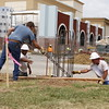 Staff photo by Harrison Grimwood<br /> A construction crew prepares a corner of Columbus Avenue and South Third Street for a concrete pedestal, where a gateway arch will be placed to distinguish Muskogee's downtown area.