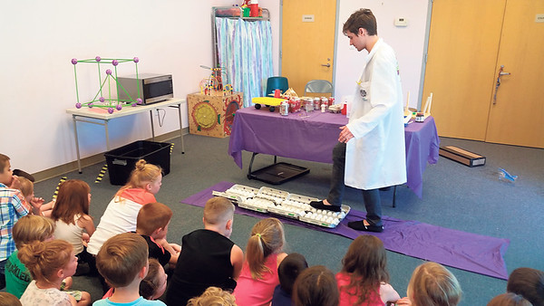 Staff photo by Cathy Spaulding<br /> Nick Gathman of Mad Science walks across eight dozen raw eggs to demonstrate their strength to children at Q.B. Boydstun Library. No egg broke.