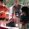 Staff photo by Cathy Spaulding<br /> Cherokee Elementary Librarian Gina Batie holds hands with Andrea Moran while chatting with Kyleigh Goodwin during a Camp Bennett science and nature class. Batie has been a counselor for two years.