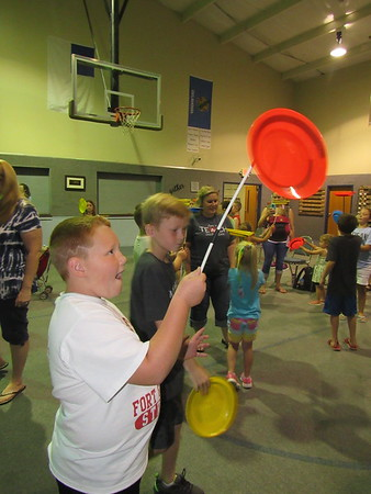 Garrett Whitehead, 6, tries twirling a disc atop a rod after a performance of the Hanson Family Jugglers on Friday.