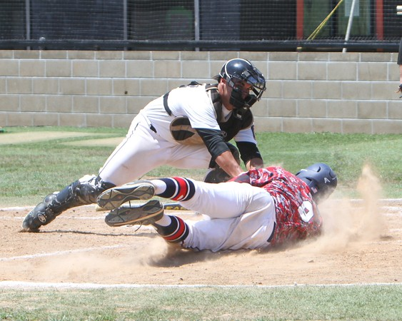 Special photo by John Hasler<br /> Three Rivers Bandits catcher Caleb Knight applies the tag on Bartlesville's Jacob Ruiz at the plate in a doubleheader at Connors State College on Sunday. Three Rivers swept the twin bill, 5-0 and 6-5.