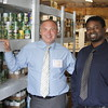 Staff photo by Harrison Grimwood<br /> Timothy Taylor, right, and Rich Schaus pose in the Gospel Rescue Mission's food pantry the afternoon before the City Council approved the partnership among the three groups for a program aimed at reintegrating felons into the workforce.