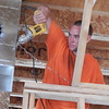 Staff photo by Mark Hughes<br /> Kalen Berrigan, a heating and air conditioning technician, trims a hole he cut Tuesday to accommodate the installation of heat and air ducts at the Sonic Drive-In being built in Wagoner.