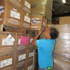 CATHY SPAULDING/Muskogee Phoenix<br /> Muskogee Public Schools Child Nutrition Services Secretary Sekora Brown pulls a box of school supplies from the MPS warehouse.