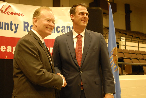 CHESLEY OXENDINE/Muskogee Phoenix<br /> Republican gubernatorial candidates Mick Cornett, left, and Kevin Stitt shake hands before a debate during Thursday night's Lincoln-Reagan dinner at the Muskogee Civic Center.