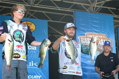 MIKE KAYS/Muskogee Phoenix Northeastern State anglers Taylor Hamburger and Carson Smith pose with their catches from day one of the Carhartt Bassmaster College Series National championship in Tahlequah.