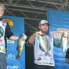 MIKE KAYS/Muskogee Phoenix<br /> Northeastern State anglers Taylor Hamburger and Carson Smith pose with their catches from day one of the Carhartt Bassmaster College Series National championship in Tahlequah.