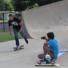 CATHY SPAULDING/Muskogee Phoenix<br /> Nathan Vanderpool, 17, of Tulsa skates past Kyle Rye, 12, of Fort Gibson, who shoots video. Skateboarders at Fort Gibson's skatepark brought water jugs and towels to keep themselves hydrated and cool during Friday afternoon's sweltering heat. Mid-90s temperatures with heat indices over 100 degrees are expected through the weekend, according to the AccuWeather website.
