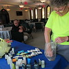 "Staff photo by Cathy Spaulding<br /> Grace Episcopal Church volunteer B.J. Charbonneau sets up toiletries in a church ""cooling shelter"" while City of Muskogee Emergency Management Manager Mark Bolding watches. Bolding encourages churches in different parts of Muskogee to become shelters."