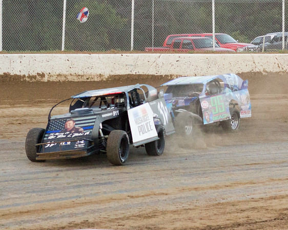 Phoenix special photo by Shane Keeter<br /> Muskogee's Ron Yates, left, gets by Devin Beach during Friday's heat race in the USRA Modified class at Thunderbird Speedway.