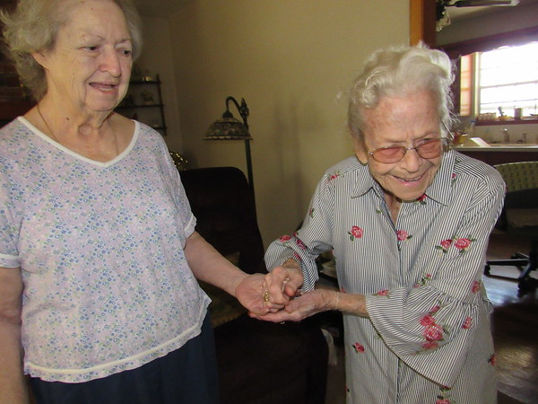 CATHY SPAULDING/Muskogee Phoenix<br /> Mary Wozniak, right, cherishes the time she spends with her sister-in-law, Betty Ashwood. The two live on£ property where Wozniak lived as a girl.