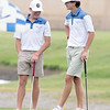 VON CASTOR/Special to the Phoenix<br /> All-State East teammates Colby Cox, right, from Hilldale and Parker Rose from Stigler wait to putt on the 10th green at Cherokee Hills Golf Course in Catoosa.