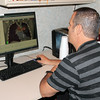 Photo by Travis Sloat<br /> Joe Hester, the dosimetrist at EASTAR Health System, looks at an image from a patient's computerized axial tomography (CAT) scan so he can develop a plan of action to administer radiation treatment. Oncologists at EASTAR have a new lung cancer screening process that uses the CAT scan to identify cancer earlier.