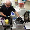 Staff photo by Mark Hughes<br /> Mike Butcher, lead technologist for EASTAR Health System's emergency department's stat lab, removes a vial of blood from a centrifuge, which spins to separate plasma from red blood cells. Except for life-threatening issues, individuals should consider using urgent care clinics, which may or may not have on-site laboratories.