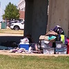Staff photo by Wendy Burton<br /> Jana Younker lies in the shade with another homeless person nearby on Monday afternoon under the Columbus Street Bridge. Despite many community members stepping up to help, Younker remains unwilling to<br /> move from beneath the bridge or seek assistance from the nearby shelter or other agencies.