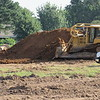Staff photo by Cathy Spaulding<br /> A bulldozer moves dirt at the site of a new Harp's supermarket to be built on South Lee Street. The store could open early next year.