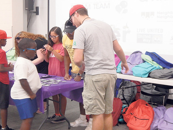ABIGAIL HALL/Muskogee Phoenix<br /> Summer learning program participants received free backpacks and school supplies from Ki Bois Community Action. Dream Team's summer learning program celebrated those who participated at the Back to School Bash with co-sponsors Non-Profit Resource Center, Lake Area United Way and Ki Bois Community Action.