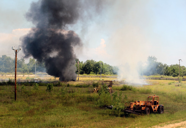 Photo by Travis Sloat<br /> Fire burns the infield of Thunderbird Speedway on Saturday afternoon. Muskogee firefighters were called to the scene. They were not sure as to the cause of the fire. OG&E was also called to the scene because of electrical lines in the infield.