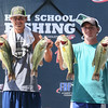 Special photo by Von Castor<br /> Dylan Nash, left, and Austin French of Shidler High School proudly display four of the five bass the duo reeled in Saturday to capture the 2015 Oklahoma high school state championship. The tournament, co-sponsored by The Bass Federation and Student Angler Federation, was held on the Arkansas River with the weigh-in at Three Forks Marina.
