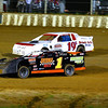 Special photo by Darren Stephens<br /> Mike Winthrow, front, passes Kyle Slader, both of Muskogee, in turn 3 during Friday's Grand National A feature at Outlaw Motor Speedway. Winthrow took the lead on lap 7 and went on to win the race.