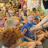 Staff photo by Cathy Spaulding<br /> A girl winces before touching an African bullfrog Friday at Q.B. Boydstun Library in Fort Gibson. The frog was one of several animals brought to help the library close out its summer reading program.