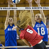 Special photo by Von Castor<br /> Summer Milligan, left, blocks a shot in the small school All-State volleyball match Tuesday night.