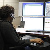 Staff photo by Harrison Grimwood<br /> Harolyn Scott, a longtime dispatcher, takes calls and dispatches personnel Tuesday, the fifth anniversary of the Muskogee City/County E911 Center.