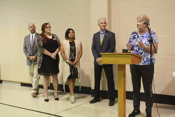 CHESLEY OXENDINE/Muskogee Phoenix<br /> (From left) Wagoner City Superintendent Dwayne Elam, Wagoner Chamber of Commerce Director Kristen Mallett, Wagoner Main Street Director Samantha Call, and Mayor Albert Jones join festival organizer Dell Davis to announce the movement of the Bluegrass and Chili Festival from Claremore to Wagoner.