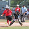 Jose Yau-Phoenix Special Photo<br /> Oklahoma Rays catcher Juliana Hutchens protects home plate, while Texas East runner Emily Smith scores during the bottom of the fifth inning of  the Little League Softball Southwest Regional Tournament game Friday in Waco, Texas. Oklahoma won 12-4.