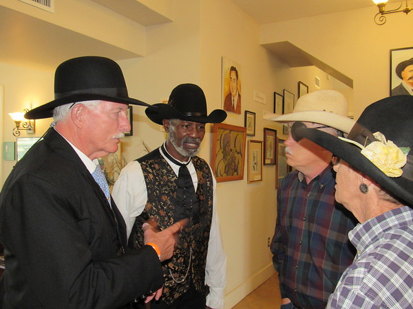 """CATHY SPAULDING/Muskogee Phoenix<br /> """"Bill Tilghman"""" (John Pryor, left) visits friends, from second left, """"Bass Reeves"""" (Ray Williams), author Thomas """"T.C."""" Miller and Jake Miller during the first day of the Bass Reeves Western History Conference on Friday."""