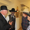 "CATHY SPAULDING/Muskogee Phoenix<br /> ""Bill Tilghman"" (John Pryor, left) visits friends, from second left, ""Bass Reeves"" (Ray Williams), author Thomas ""T.C."" Miller and Jake Miller during the first day of the Bass Reeves Western History Conference on Friday."