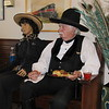 Lawman Heck Thomas (Ivan Pace) has a reception snack beside a mannequin at Three Rivers Museum during Friday's session of the Bass Reeves Western History Conference.