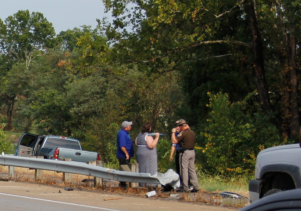 Staff photo by Harrison Grimwood<br /> Oklahoma Highway Patrol troopers investigate the accident scene on U.S. 62.