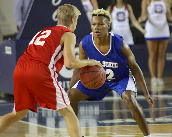 Phoenix special photo by Von Castor<br /> Okay's Darius Riggs, right, playing for the Small School East squad, guards a player from the West in Thursday All-State game at the Mabee Center, The East fell 87-71.
