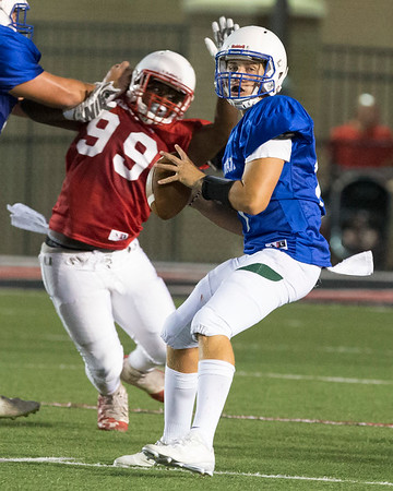 VON CASTOR/Phoenix Special Photo<br /> Muskogee's Jacob Medrano looks for an open receiver as a West defender closes in Friday night in the All-State football game at Union Tuttle Stadium in Tulsa.