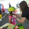 "KENTON BROOKS/Muskogee Phoenix<br /> Emaline Hill of Tahlequah, left, gets fitted with a new bicycle helmet by Tisha Barnes of the Warren Clinic on Saturday at the Saint Francis Hospital Muskogee Summer Safety Fest. Emaline said she learned that ""you should always wear a helmet because if you don't, you could crack your head open."""