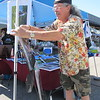 CATHY SPAULDING/Muskogee Phoenix<br /> Digital artist Ron Pitts sets up paintings at his booth at a recent Main Street Art Crawl in downtown Muskogee.