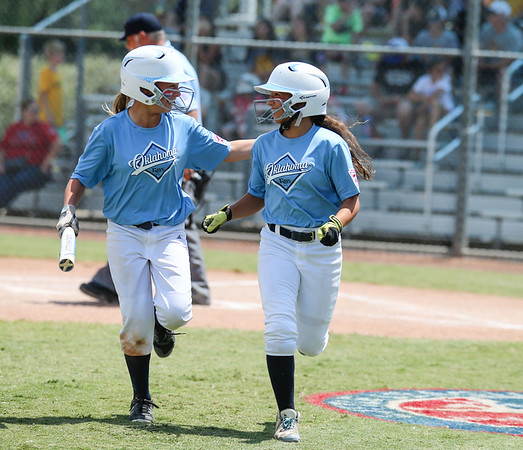 JOSE YAU/Phoenix Special Photo<br /> Oklahoma Rays Shay Grissom (left) and BrenLee Morgan celebrate after scoring two runs in the top of the third inning, during the Little League Softball Southwest Regional tournament on Saturday in Waco, Texas.
