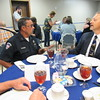 Staff photo by Cathy Spaulding<br /> Checotah Police Investigator Andy Blizzard, left, visits with Checotah First Assembly of God Pastor Bud Shackelford during a police appreciation luncheon Friday at the church. Shackelford said the church had wanted for several years to honor police.