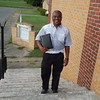 Staff photo by Mark Hughes<br /> The Rev. Gary Hall Sr. stands on the steps of Mount Cavalry Baptist Church. The building will be replaced with a 4,000-square-foot structure on the same site.