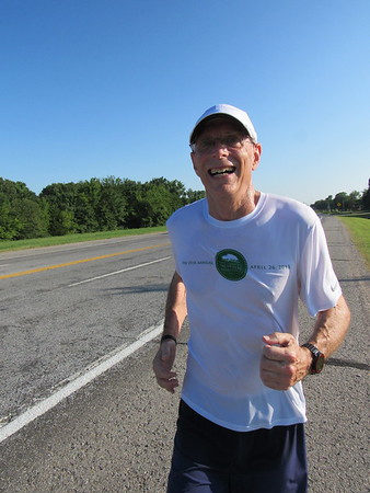 Staff photo by Cathy Spaulding<br /> At 61, Mike Smith keeps fit by running 40 miles a week. He runs a marathon every other year.