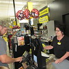 CATHY SPAULDING/Muskogee Phoenix<br /> Lee Jackson uses a PIN pad while cashier Diane Woodard waits at Fort Gibson's new, larger Dollar General Store.