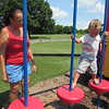 CATHY SPAULDING/Muskogee Phoenix<br /> Left: Dee Dee Stevenson of Fort Gibson watches her 3-year-old grandson Greyson Pitts make his way across hanging platforms at Civitan Park's playground. Stevenson said that six months ago, the boy was afraid to go on the platforms.