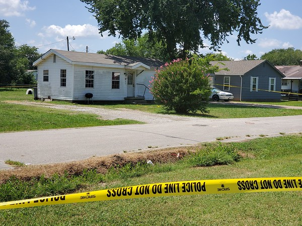 An attack took place at a home in the 300 block of West Hickory Street in Haskell on Tuesday morning in an alleged home invasion attempt which ended in a shootout. Damage from the assault remains visible on the front of the house.